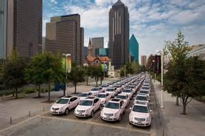 Pink Cadillacs in procession at the 50th anniversary celebrations in Dallas, Texas.